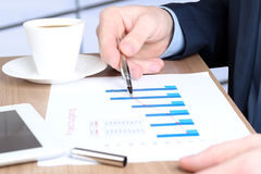 Modern business man  doing business, graphs and charts behind Stock Photos