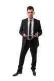 Modern business man howding an ipad Royalty Free Stock Photos