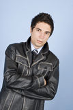 Modern business man in leather jacket Royalty Free Stock Image