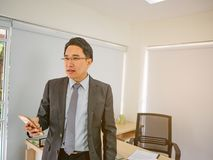 Modern business man look serious in his office stock photos