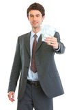 Modern business man showing pack of euros Royalty Free Stock Images