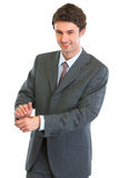 Modern business man showing tossed coin Royalty Free Stock Photos