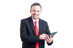 Modern business man using tablet Stock Image
