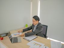 Modern business man working very busy on his desk royalty free stock images