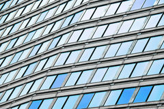 Modern business office building blue glass windows Royalty Free Stock Photo