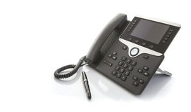 Modern Business Office IP Telephone with pen stock photography
