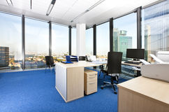 Modern business office with panoramic cityscape Stock Images