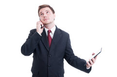 Modern business person using phone and tablet as multitasking co Stock Images