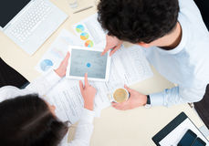 Modern business planning. Business team working on a new business plan with modern digital computer. Top view shot