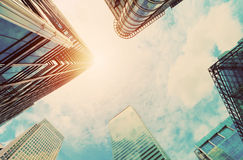Modern business skyscrapers, high-rise buildings architecture in vintage mood. Modern business skyscrapers, high-rise buildings, architecture raising to the sky royalty free stock photography
