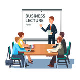 Modern business teacher giving presentation. Modern business teacher giving lecture or presentation to a group of employees. Standing in front of whiteboard with Stock Photo