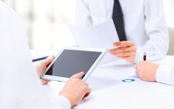 Modern business team using tablet Royalty Free Stock Image