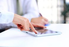 Modern business team using tablet Royalty Free Stock Photo