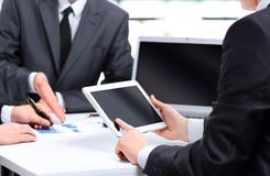 Modern business team using tablet Royalty Free Stock Photos