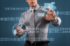 Modern business technology. Modern businessman working with touch screen technology Royalty Free Stock Photos