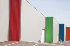 Business units with colorful roller doors building royalty free stock photos