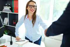 Modern  business woman with arm extended to handshake Royalty Free Stock Photography