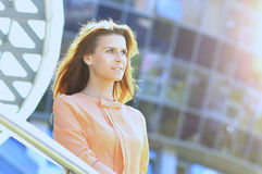 Modern business woman on the background of the office in a bright sunny day. Modern business woman on the background of the office in bright sunny day royalty free stock images