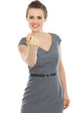 Modern business woman beckoning with finger. Business woman beckoning with finger stock image
