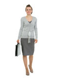 Modern business woman with briefcase making step f Royalty Free Stock Image