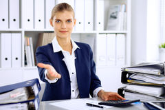 Modern business woman or confident female accountant offering helping hand Royalty Free Stock Photography