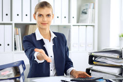 Modern business woman or confident female accountant offering helping hand Stock Images
