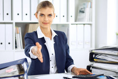 Modern business woman or confident female accountant offering helping hand Royalty Free Stock Images