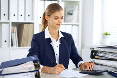 Modern business woman or confident female accountant in office. Student girl during exam preparing. Audit, tax service Stock Photography