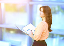 Modern business woman with documents stock photography