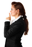 Modern business woman with finger at mouth Royalty Free Stock Photography