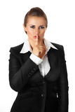 Modern business woman with finger at mouth. shh ge. Modern business woman with finger at mouth isolated on white stock images
