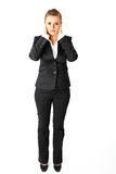 Modern business woman with hand on ears Stock Photos