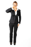 Modern business woman with hand on mouth Royalty Free Stock Image
