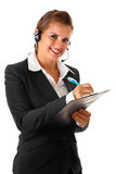 Modern business woman with headset and notebook Royalty Free Stock Photo