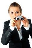 Modern business woman looking through binoculars Royalty Free Stock Photo