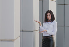 Modern business, woman near the office ponders business plan Stock Photo