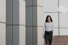 Modern business, woman near the office ponders business plan Stock Image