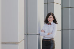 Modern business, woman near the office ponders business plan Royalty Free Stock Photos