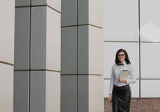 Modern business, woman near the office ponders business plan Stock Photos