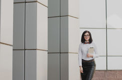 Modern business, woman near the office ponders business plan Royalty Free Stock Image