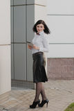 Modern business, woman near the office ponders business plan Royalty Free Stock Photo