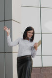 Modern business, woman near the office ponders business plan Royalty Free Stock Photography