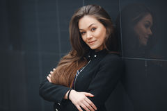 Modern business, woman near the office ponders business plan. Stock Photo