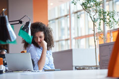 Modern business woman in the office Stock Photos