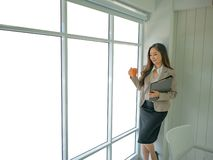 Modern business women in the office stock images
