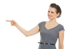 Modern business woman pointing in corner Royalty Free Stock Images