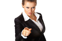Modern business woman pointing finger at you. Isolated on white royalty free stock image