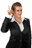Modern business woman with rised finger. idea gest Royalty Free Stock Images