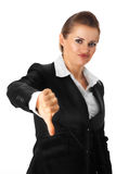 Modern business woman showing thumbs down gesture. Isolated on white royalty free stock photography