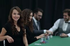 Modern business woman sitting at craps table in a casino. stock photo